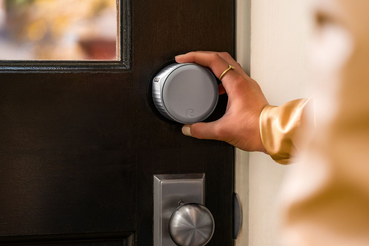 An August Wi-Fi Smart Lock being used to lock the door.