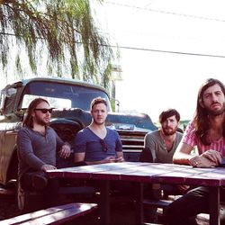 """""""Imagine Dragons"""" is on its way to the top of the charts with inventive, fresh songs that combine a violinist, a cellist and electric guitars. D Wayne Sermon, far right at the table, is LDS as is Dan Reynolds, 2nd right."""