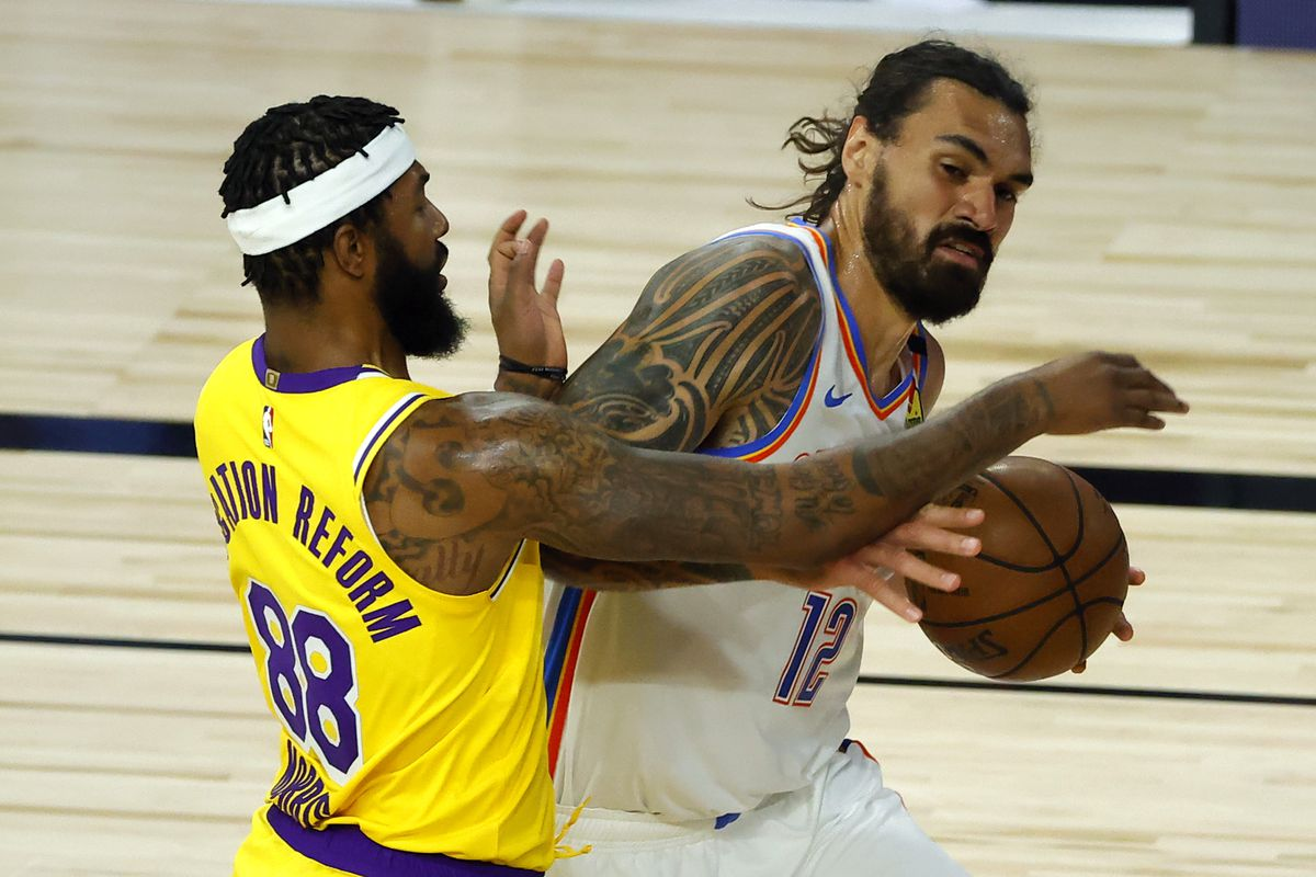 Steven Adams of the Oklahoma City Thunder is defended by Markieff Morris of the Los Angeles Lakers during the second quarter at HP Field House at ESPN Wide World Of Sports Complex on August 05, 2020 in Lake Buena Vista, Florida.
