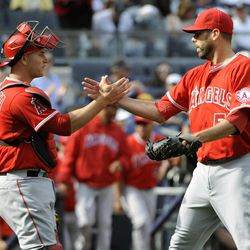 Los Angeles Angels pitcher Jordan Walden, right, celebrates with catcher Chris Iannetta after the Angels defeated the New York Yankees 7-1 during a baseball game Saturday, April 14, 2012, at Yankee Stadium in New York.