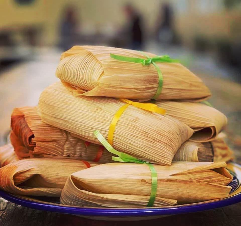 Plates of tamales tied with ribbons