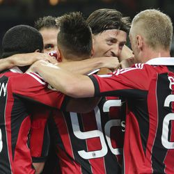 AC Milan forward Stephan El Shaarawy, covered by his teammates, celebrates after scoring during the Serie A soccer match between AC Milan and Cagliari at the San Siro stadium in Milan, Italy, Wednesday, Sept. 26, 2012.