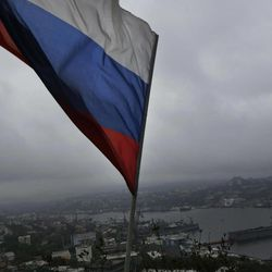 A Russian flag flies above the port in the eastern Russian city of Vladivostok Wednesday, Sept. 5, 2012. Once a mysterious closed city during Soviet times, Vladivostok is ready to strut in the world spotlight as host of the Asia-Pacific Economic Cooperation summit. Russia has splashed $20 billion preparing for the summit in Vladivostok, its largest but long-neglected Pacific port, as part of a grand plan to become a bigger player on Asian markets.