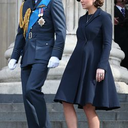 Leaving a service of commemoration for British troops who were stationed in Afghanistan on March 13th, 2015 in a navy Beulah London coat.