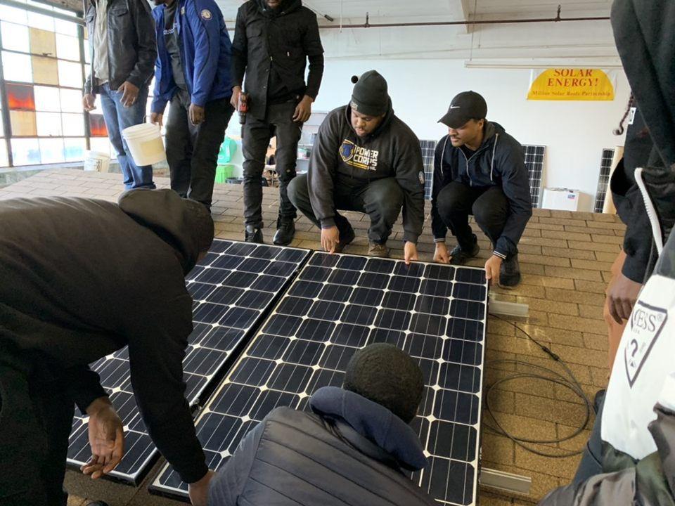 In Philadelphia, PowerCorpsPHL members receive training on installing solar panels.