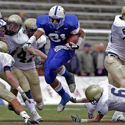 Bingham's Harvey Langi, here in a game against Skyline, has to be one of the favorites for the Mr. Football award.  ((center)(Bingham) runs through the defense of Skyline in the 5A high school semi-final State Championship game at Rice-Eccles at the University of Utah.  November 13, 2008.