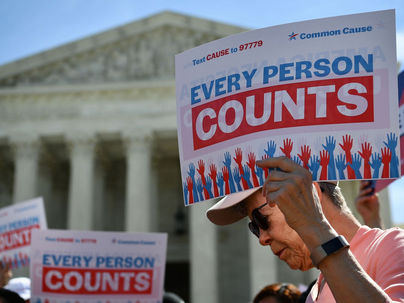 Demonstrators rally at the US Supreme Court in Washington, DC, on April 23, 2019, to protest a proposal to add a citizenship question in the 2020 census.