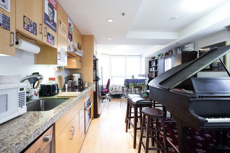 A photo of Paul Hogarth's home, a 400-square-foot condo that he shares with a large, grand piano.