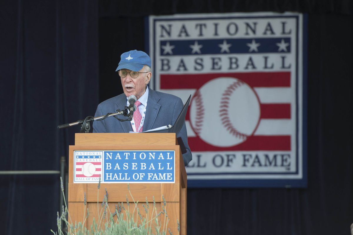 Roger Angell, who wrote one of the columns linked below, receiving the JG Taylor Spink Award at Cooperstown this past summer