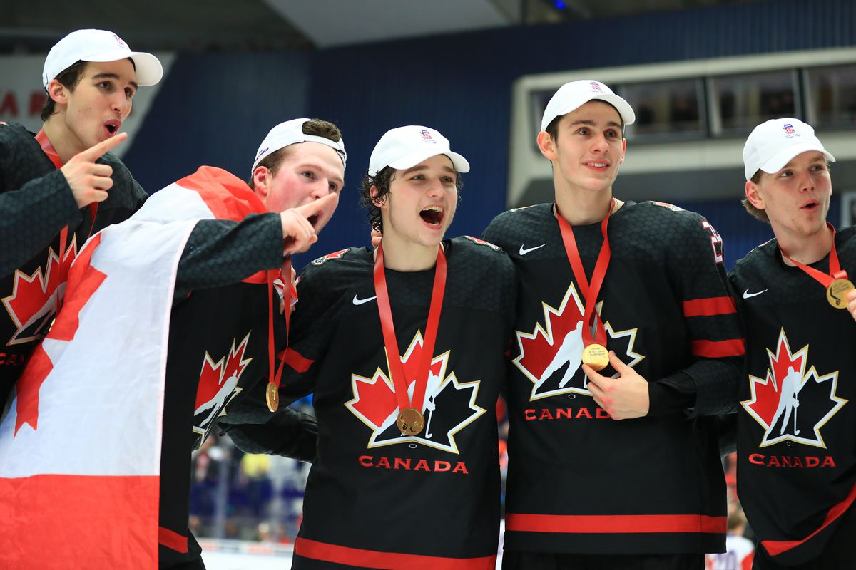 OSTRAVA, CZECH REPUBLIC - JANUARY 5, 2020: Canadian players pose with their gold medals during the medal ceremony for the 2020 World Junior Ice Hockey Championship final match between Canada and Russia at Ostravar Arena; Canada won 4-3.
