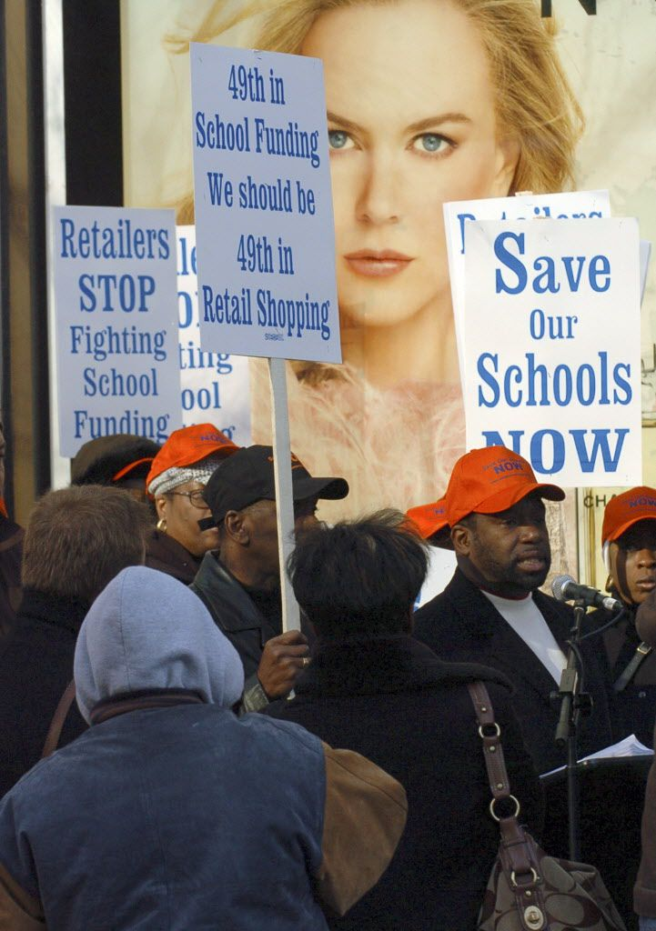 Rev. James meeks leads a protest march on north Michigan ave. supporting fair school funding in 2008. File Photo. Brian Jackson/Sun-Times