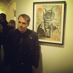 "Shepard Fairey with his cat artwork. Photo via <a href=""http://instagram.com/p/jqMCgBnLKM/""target=""_blank"">@aniaxix</a>."