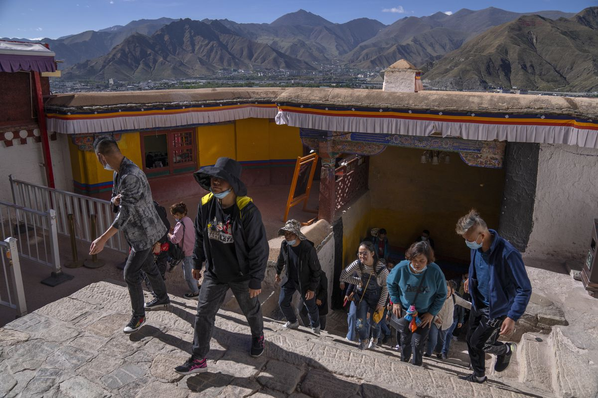 Tourists climb stairs at the Potala Palace in Lhasa, West China's Tibet Autonomous Region.
