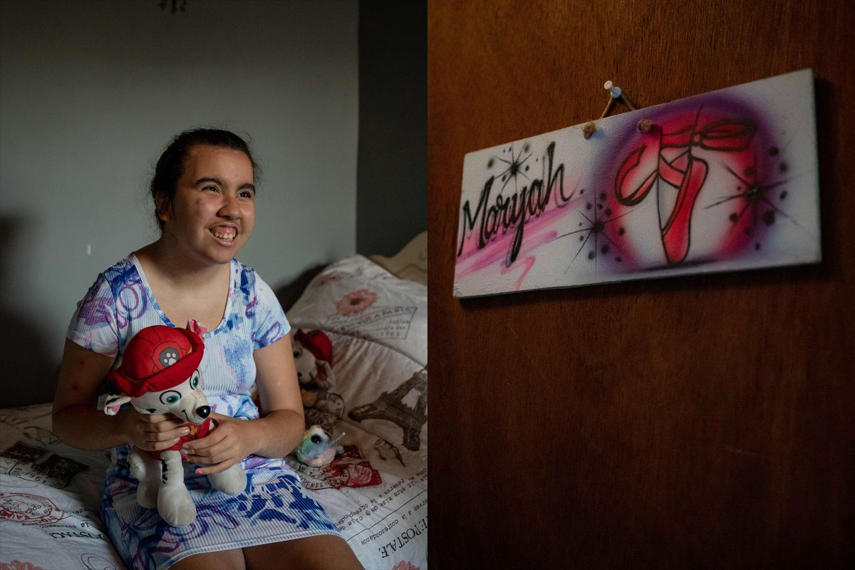 """(Left) A teenaged girl holds a stuffed animal while sitting on her bed. (Right) A custom door sign reads """"Maryah"""" with pink and purple highlights."""