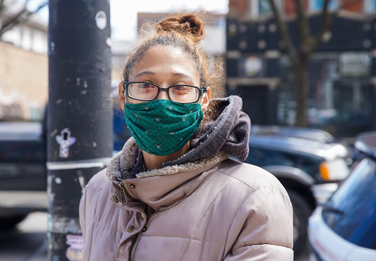 "Tera Petty, 32, of Wicker Park, wears a green mask with ducks. ""I love the ducks on it. I thought it was cute and different and I love the color with my skin tone."""