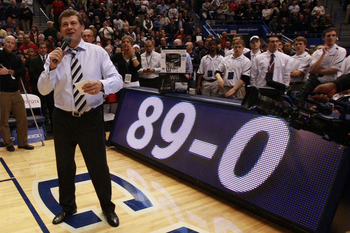HARTFORD CT - DECEMBER 21:  Coach Geno Auriemma of Connecticut celebrates a win over  Florida State on December 21 2010 in Hartford Connecticut.  Connecticut set a record with 89 straight wins without a defeat. (Photo by Jim Rogash/Getty Images)