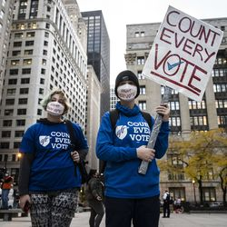 Ayla Naomi, 12, and her sibling Lea Mira, 14, from Old Town, join hundreds of protesters to rally in Daley Plaza before marching through the Loop to demand every vote be counted in the general election, Wednesday night, Nov. 4, 2020.
