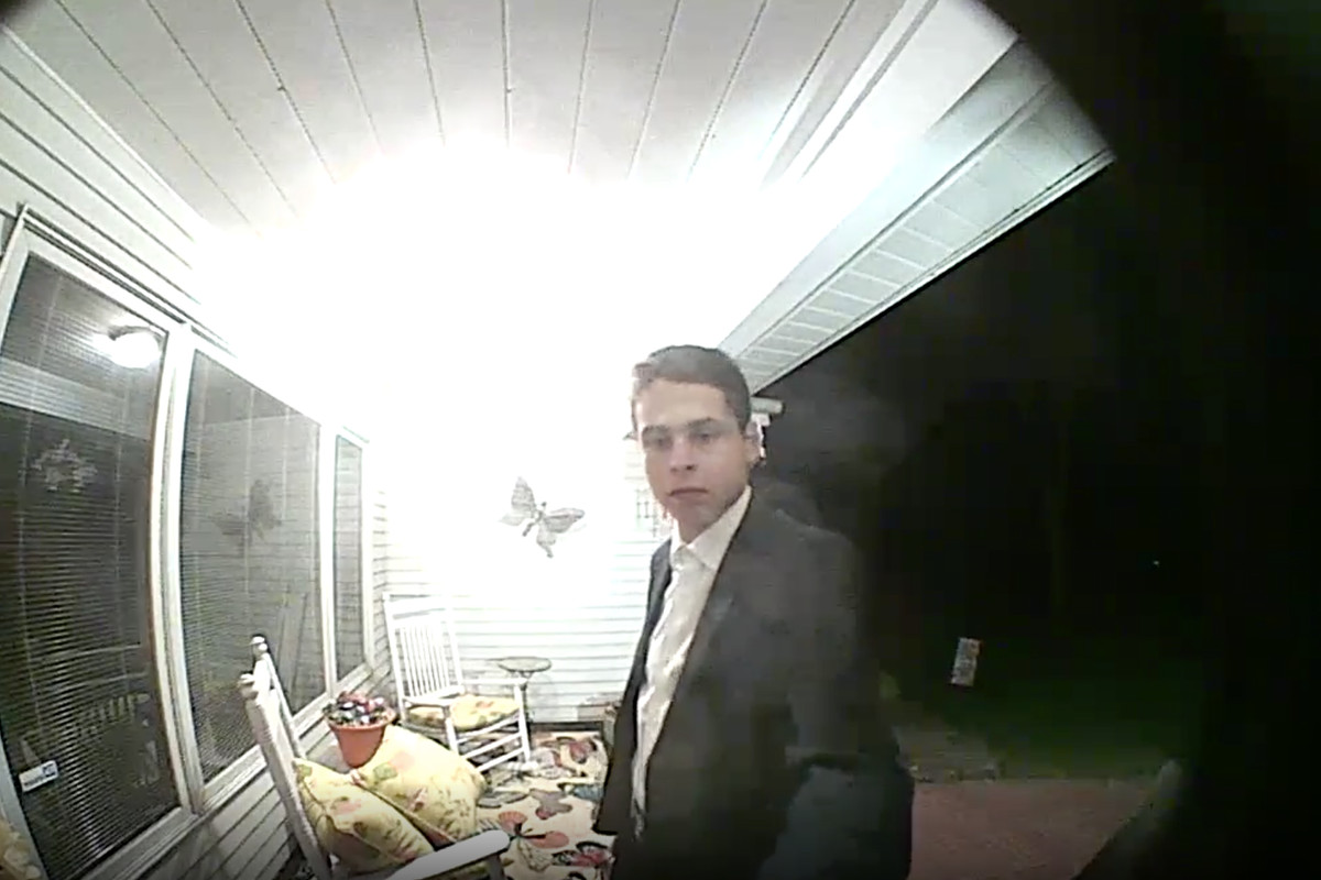 Still from a clip recorded by a video doorbell allegedly showing Thomas Kozie posing as a police officer in West Chicago.