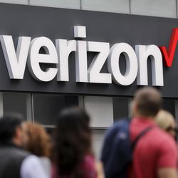 In this Tuesday, May 2, 2017, photo, Verizon corporate signage is captured on a store in Manhattan's Midtown area, in New York. On Tuesday, June 13, 2017, Verizon took over Yahoo, completing a $4.5 billion deal that will usher in a new management team to attempt to wring more advertising revenue from one of the internet's best-known brands. Tuesday's closure of the sale ends Yahoo's 21-year history as a publicly traded company. It also ends the nearly five-year reign of Yahoo CEO Marissa Mayer, who isn't joining Verizon.