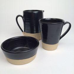 Farmhouse Pottery black glaze pieces (exclusive to Good), including medium black silo pitcher, originally $110, now $55; tall black silo mug, originally $55, now $27.50; and black silo bowl, originally $55, now $27.50