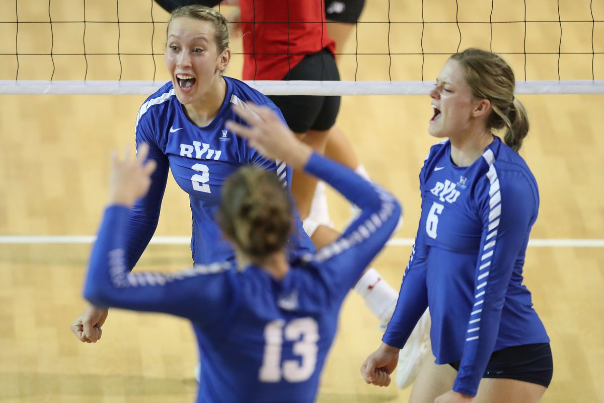 BYU's Heather Gneiting (2) and BYU'S Lyndie Haddock-Eppich celebrate a point against Utah in Provo on Thursday, Sept. 13, 2018.