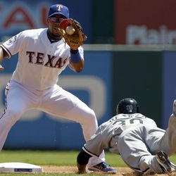 Texas Rangers shortstop Elvis Andrus catches Chicago White Sox's Alejandro De Aza (30) trying to steal second during first inning of a baseball game Friday, April 6, 2012 in Arlington, Texas.