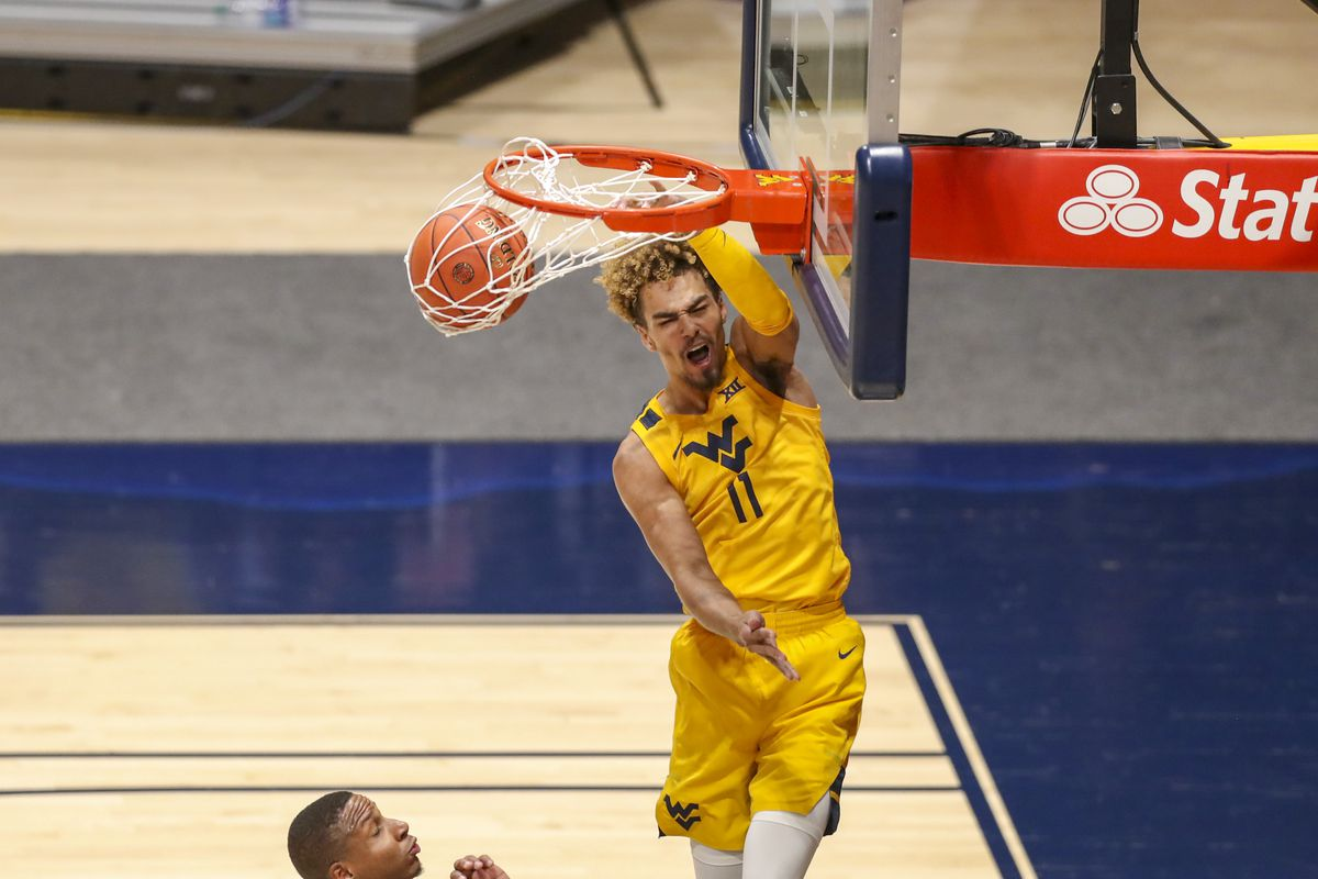 West Virginia Mountaineers forward Emmitt Matthews Jr. dunks the ball during the second half against the Baylor Bears at WVU Coliseum.