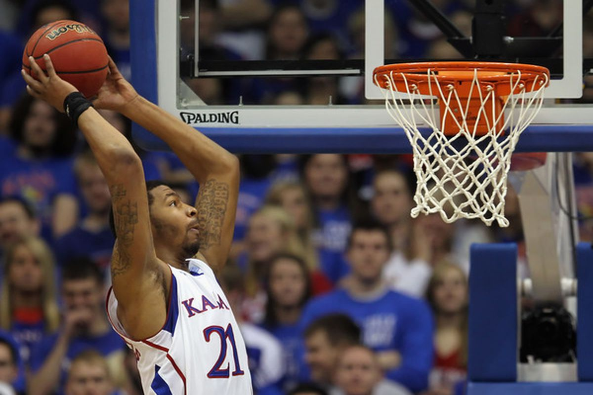 LAWRENCE KS - FEBRUARY 12:  Markieff Morris #21 of the Kansas Jayhawks dunks during the game against the Iowa State Cyclones on February 12 2011 at Allen Fieldhouse in Lawrence Kansas.  (Photo by Jamie Squire/Getty Images)