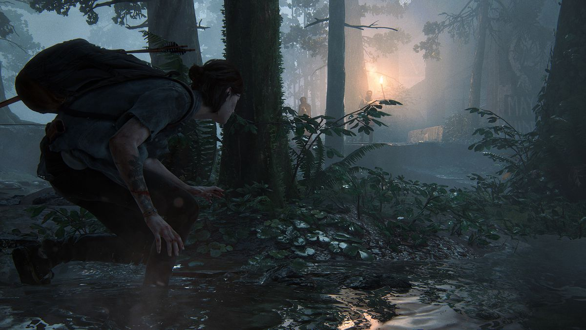 Ellie hides among trees in a screenshot from The Last of Us Part 2