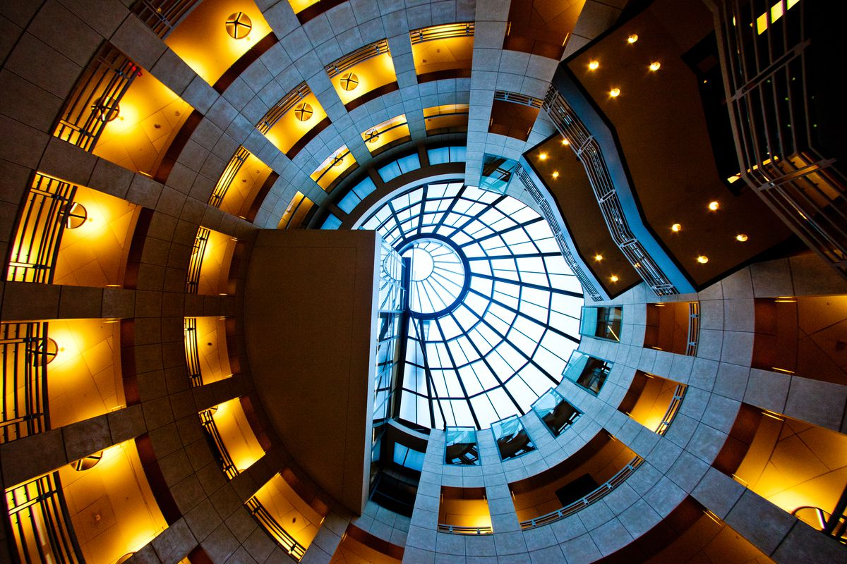 The interior of the San Francisco Public Library. This is a view looking up at the ceiling of the circular shaped atrium. The ceiling has a skylight.