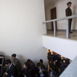 International and North Korean media climb stairs during a tour of North Korea's space agency's General Launch Command Center on the outskirts of  Pyongyang Wednesday, April 11, 2012. Engineers are pumping fuel into a rocket that is set to carry a satellite into space, officials at the North Korean space agency's central command center said Wednesday, showing reporters a live feed of the west coast launch pad.