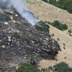 Hand crews work a fire during on the mountain above Farmington on Friday, June 23, 2017.