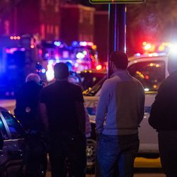 Local residents watch as SWAT teams respond to a man who implied he had a gun, Saturday night, in the 2400 block of Bryn Mawr, in the Arcadia Terrace neighborhood.   Tyler LaRiviere/Sun-Times