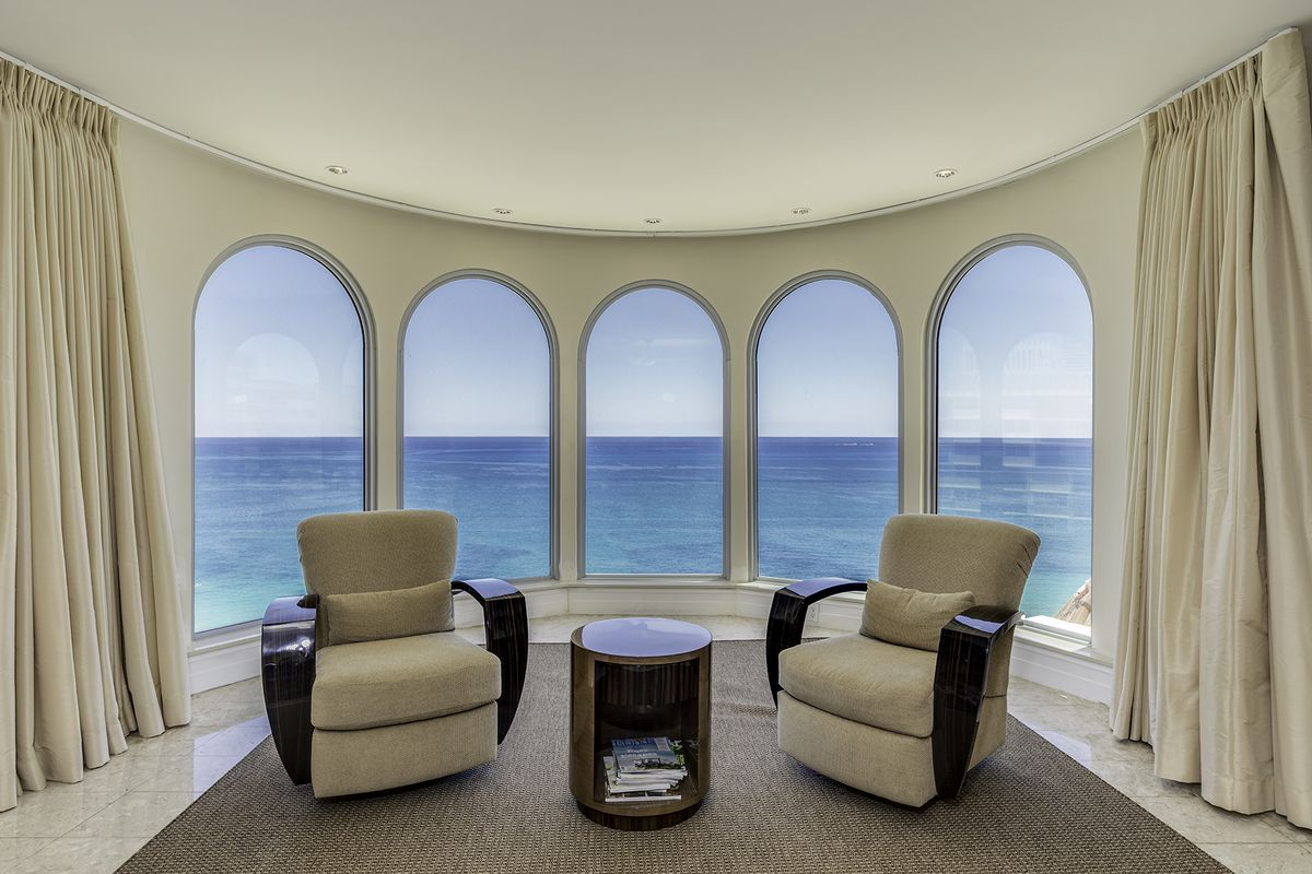 An oceanfront view in the master bedroom of a florida penthouse