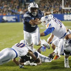 Brigham Young Cougars running back Ula Tolutau (5) scores a touchdown against the Boise State Broncos in Provo on Friday, Oct. 6, 2017.