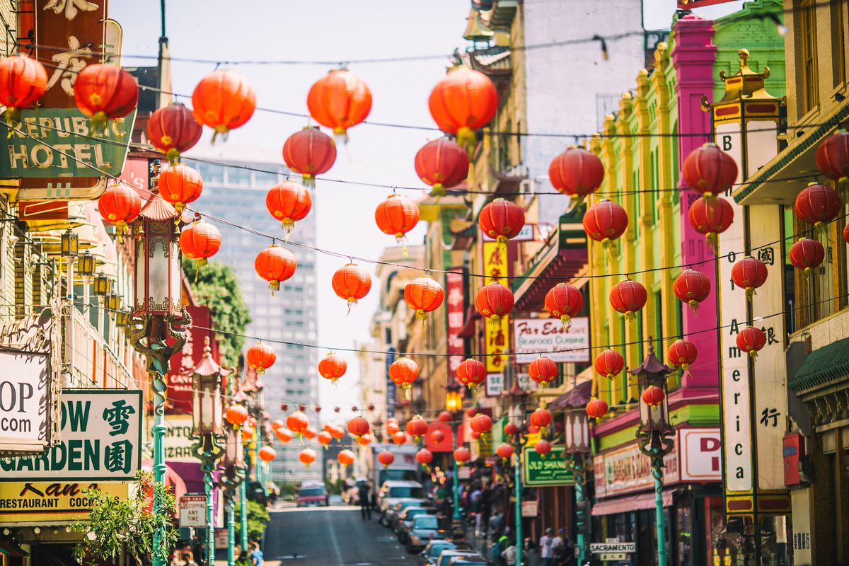Chinatown San Francisco, with red lanterns abive the streets.