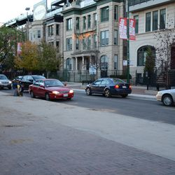 """4:34 p.m. Cars """"double parked"""" on Sheffield, where the sod was being given away -"""