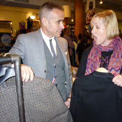 Thom Browne enlightens a shopper on how to best purchase a Brooks Brothers cape during the sale preview