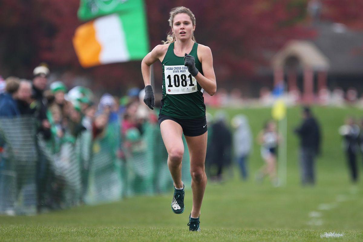 Glenbard West's Katelynne Hart wins the IHSA Regional race in an unofficial time of 15:57, Glendale Heights.