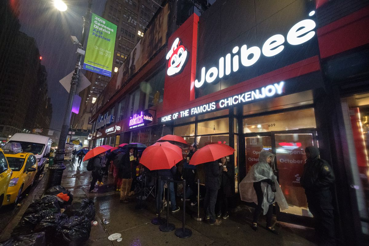 Customers lined up outside a location of Jollibee's in Manhattan
