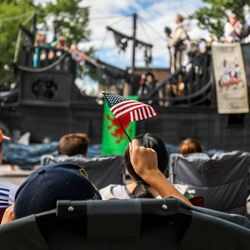 A child waves an American flag during the Grand Parade in Provo on Monday, July 5, 2021.