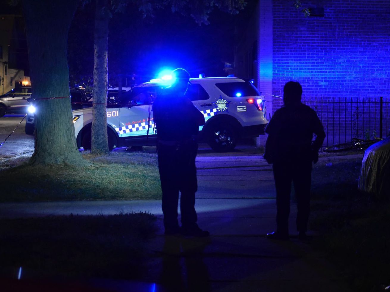 Chicago police investigate after a woman and a 4-year-old boy were shot Sept. 4, 2020, in the 8600 block of South Honore Street.
