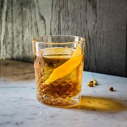 An Old Fashioned with Chairman's Reserve spiced rum, rustic sugar, cardamom bitters, decanter bitters