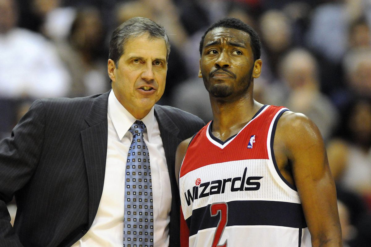 Mar 30, 2012; Washington, DC, USA; Washington Wizards point guard John Wall (2) and head coach Randy Wittman talk during the second half at the Verizon Center. The Wizards defeated the 76ers 97 - 76. Mandatory Credit: Brad Mills-US PRESSWIRE
