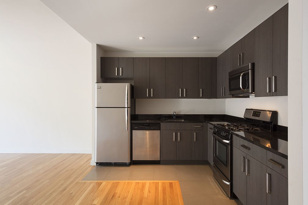 A kitchen with dark wood cabinetry.