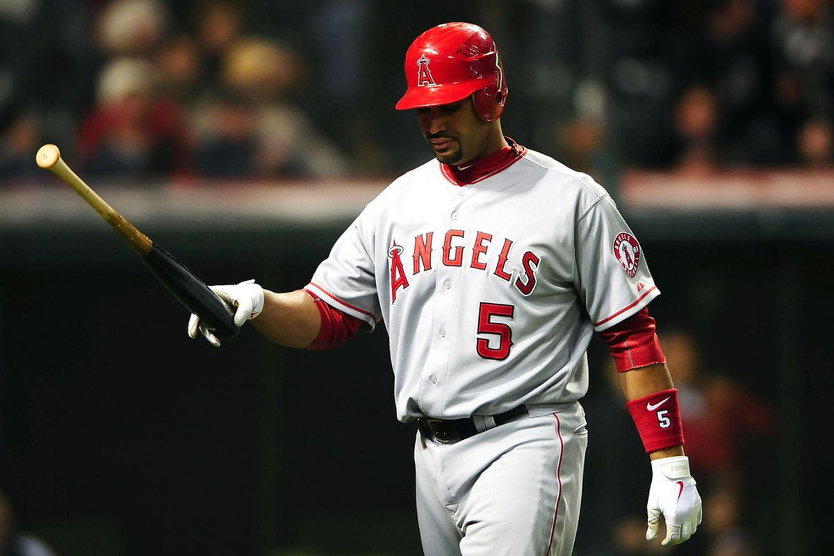April 27, 2012; Cleveland, OH, USA; Los Angeles Angels first baseman Albert Pujols (5) walks to the dugout after striking out in the eighth inning against the Cleveland Indians at Progressive Field. Mandatory Credit: Andrew Weber-US PRESSWIRE