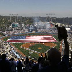 Los Angeles Dodgers fans cheer during opening day celebration before a baseball game against the Pittsburgh Pirates in Los Angeles, Tuesday, April 10, 2012.