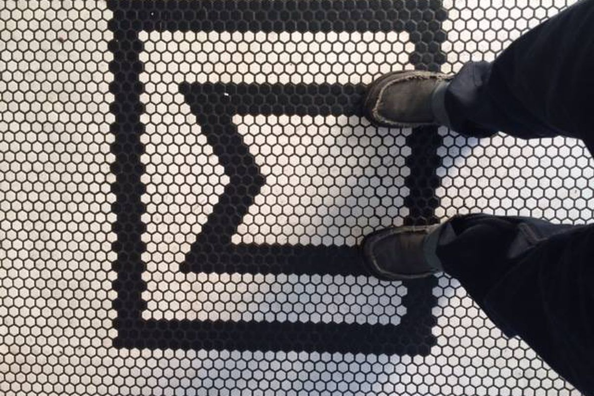 The letter M in a tile floor at what was once Martino's Smoked Meats.