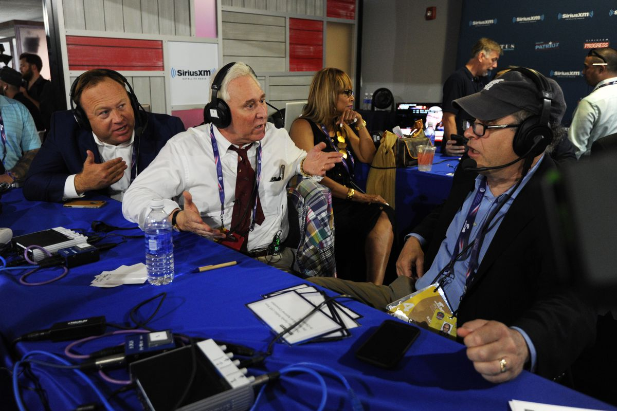 Alex Jones of Infowars, Roger Stone and Jonathan Alter wearing headphones and recording a radio interview