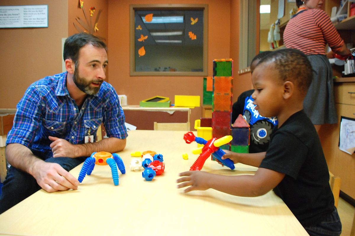 A staff member works with preschoolers at Educare Denver at Clayton Early Learning.